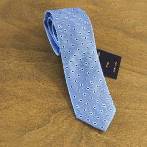 Cravatta a pois fondo celeste mod. 109